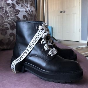 Black combat style boots with retro laces